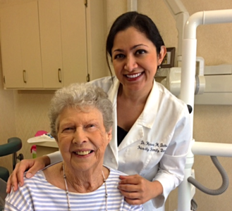 Dr. Henna with a Patient